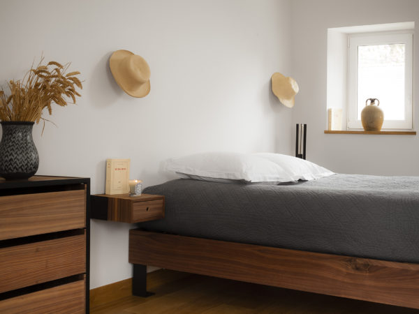 Designer bed in wood and metal